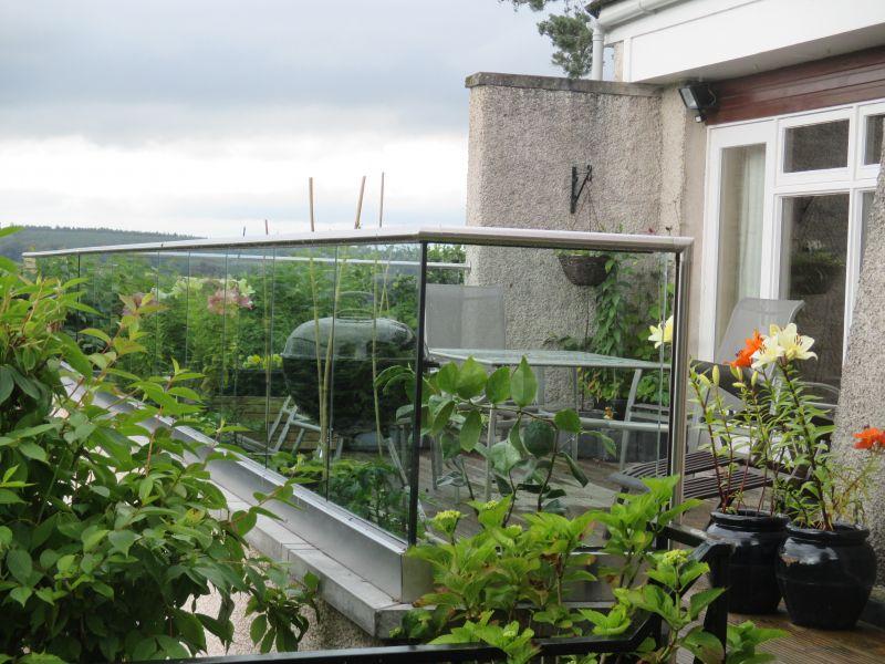 Glass balustrade balcony over garage